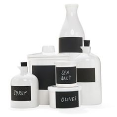 Write On  What's black and white and chic all over? These ceramic storage containers with chalkboard labels bring a harmonious minimalism to the messiest kitchen.      Read more: http://www.oprah.com/gift/Write-On?editors_pick_id=37988#ixzz20P12zbWr