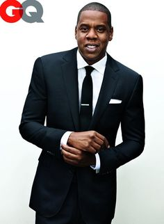 Take a tip from Jay-Z and stick with a classic black suit and white shirt for a professional look.