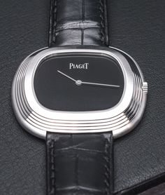 "If one could distill a tuxedo into wristwatch form, no doubt it would resemble the Piaget Black Tie ""Vintage Inspiration. Cool Watches, Watches For Men, Most Popular Watches, Watch Blog, Metal Texture, Wearable Device, Men Formal, Vintage Models, High Jewelry"