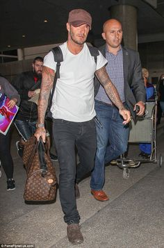 Back to reality! David Beckham was spotted arriving at LAX airport in Los Angeles, Califor...