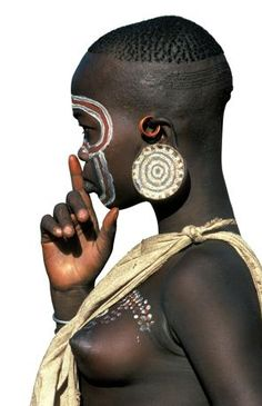 Africa | A Surma girl from the Omo Valley in Ethiopia | Just one of the many fantastic photographs included in the publication 'Painted Bodies: African Body Painting, Tattoos and Scarification' by Carol Beckwith and Angela Fisher ~ Release date Sept 18th 2012. { http://www.amazon.com/Painted-Bodies-African-Painting-Scarification/dp/0847834050 }
