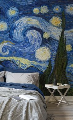"""Sleep easy under Van Gogh's dreamlike """"Starry Night"""" masterpiece. The swirling paintbrush strokes of this art wallpaper brings a truly unique texture to your walls. Coordinate your interiors with blue tones to complete the look."""