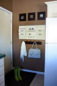 """Front door organization...need space for incoming mail, outgoing mail, bills to pay, shopping list, mirror, dry erase or chalkboard, place for cell phones/random items, maybe coat hooks (for purse, dog leash) or small table, possible """"random holder"""" for dog poop bags, etc. Use our current key hook holder"""