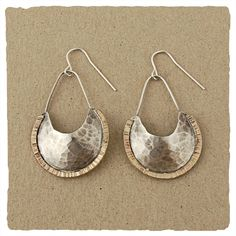 """These formed and textured earrings are paired to perfection and edged in a 14kt goldfill flare.  Earring measures approximately 7/8"""" wide and drops 1 1/2"""" from the sterling hook."""