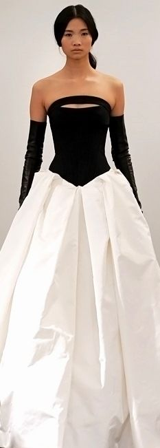 Vera Wang 2014 - I am SO on the fence with this one because it has this weird 80's volume around the pleats of the skirt... But I'm strangely drawn to it.