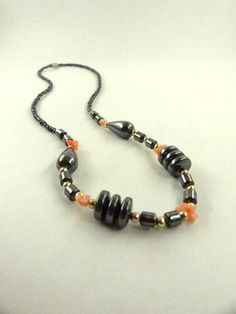 Hematite and Coral and Gold Toned Beads by ToppyToppyKnits on Etsy, $22.00