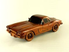 Take a spin with this classic Corvette! This hand crafted scale model of the 1962 Chevrolet Corvette is made from solid mahogany with finely carved details. Finished with multiple coats of polyurethane for high gloss and deep wood grain. Dimensions: x x Wooden Toy Cars, Wood Toys, Classic Corvette, Wooden Gifts, Chevrolet Corvette, Wood Design, Toys For Boys, Wood Art, Wood Crafts