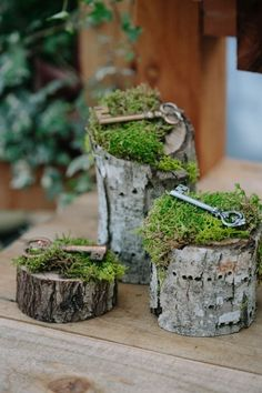 wood stumps with moss and vintage keys for wedding decor
