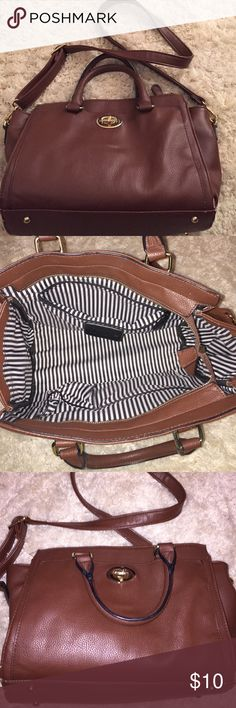 Purse Brown cross body purse slight used. Only marked on the bottom of the bag. Inside lining clean with 2 pockets and a zipper. Charming Charlie Bags Crossbody Bags