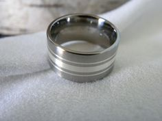 Titanium Ring Silver Inlay Wedding Band Unique Style. $75.00, via Etsy.