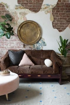 Designed by iconic Brazilian Mid-century furniture maker Percival Lafer, this suede sofa is a plush and stylish addition to your living room.