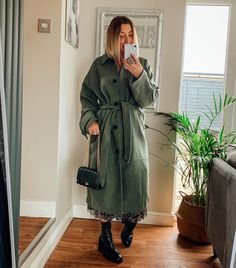 Green long coat and lace up boots | For more style inspiration visit 40plusstyle.com