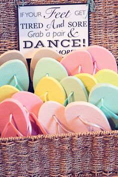 wedding dancing flip flops in wicker basket. Photography by one thousand words wedding photographers
