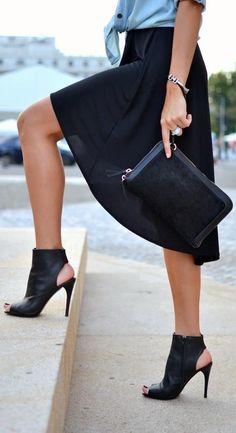 black skirt, booties,clutch