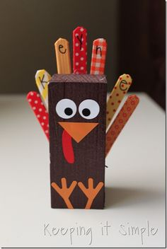 2x4 Place Setting Turkey. Feathers are washi tape covered popsicle sticks.