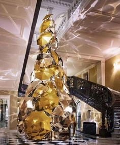 This Christmas tree in the lobby of this 5-star hotel is comprised of over 100 gold and silver metallic umbrellas, incorporates thousands of lights with motion sensors, programmed to sparkle and glitter as you approach the tree. For an added twist, some of the umbrellas are also programmed to move.