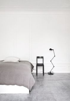 Bedroom with concrete floor. Norm Architects
