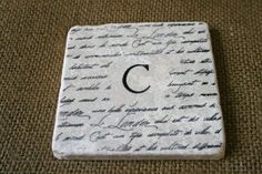 Monogrammed stone coasters - Have to remember to do this for Christmas gifts!