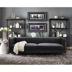 TOV-S86 Aviator Grey Velvet Sofa   Your room will soar to new heights with the stylish Aviator sofa. Offering a contemporary flair with a touch of sophistication, this velvet sofa is unique yet comfor