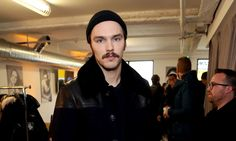 Nicholas Hoult has a moustache now, and we're not sure if we're hot for it or not. Except we definitely are