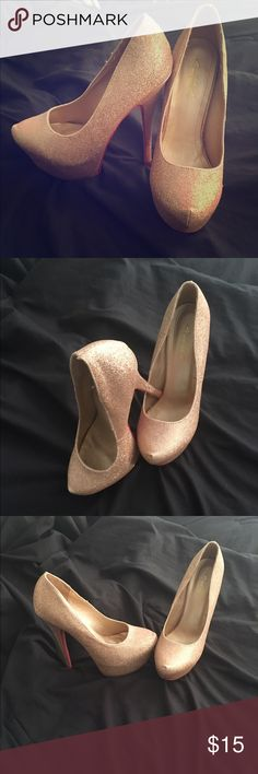 Gold sequin pumps size 7 Never worn though I don't have the original box. Super high gold sequin pumps size 7.  Bottom of the shoe is bright red (not louboutins however) Shoes Heels