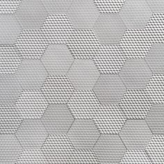 HELIOT & CO     SURFACES.  Textured tile, made from jesmonite