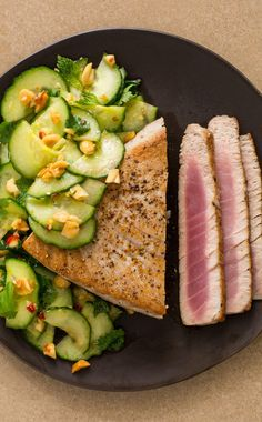 Tuna Steaks with Cucumber Peanut Salad: These simply seared tuna steaks are complemented by a pungent cucumber salad, livened up with lime, fish sauce, and roasted peanuts. Together, they make for a light, flavor weeknight meal that's ready in less than 10 minutes.
