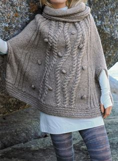 Free Knitting Pattern for Cabled Poncho - Cowl-neck poncho with armholes featuring winding braided cables and bobbles. Designed by Bergère de France. Available in English and French. Two sizes: S/M and L/XL Poncho Knitting Patterns, Loom Knitting, Free Knitting, Knit Patterns, Knitted Poncho, Knitted Shawls, Poncho With Sleeves, Wool Shop, Knit Or Crochet