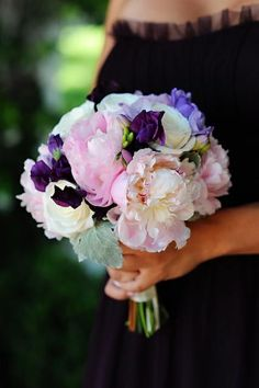 Pretty purple and pink bouquet. I really like the deep purple scattered amongst the pale flowers.
