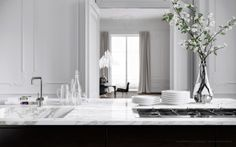 Love the island of this kitchen, w/ stovetop and sink