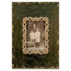 """Distressed picture frame.   Product: Picture frameConstruction Material: Metal and ironColor: Black and creamFeatures:  Distressed finishHolds one photo Dimensions: 10"""" H x 7.5"""" W"""