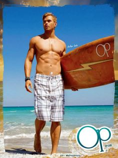 Kellan Lutz wears board shorts and carries surfboard in Spring Summer 2013 Op campaign
