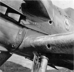 """Nose of the German fighter Messerschmitt Bf.109 F2 of I./JG51 (I group, squadron """"Mölders"""") with bullet holes by 20-mm aircraft cannon."""