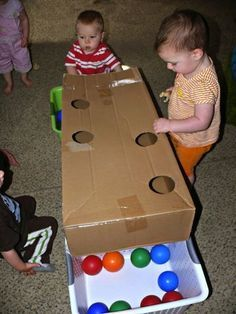 Infant & Toddler Fun: Balls, Bells, a Basket, and a Box What a terrific idea for a box! This simple game will keep young toddlers busy for a long time! Thanks to Dot to Dot Childcare for this. Toddler Play, Baby Play, Toddler Crafts, Crafts For Kids, Infant Toddler Classroom, Infant Play, Toddler Stuff, Infant Activities, Preschool Activities