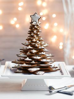 Show off your baking skills with this pretty gingerbread Christmas tree, the kids will love helping too! Find this fun Christmas recipe at Tesco Real Food. Gingerbread Christmas Tree, Christmas Tree Template, Gingerbread Cake, Xmas Tree, Christmas Cocktails, Christmas Desserts, Holiday Treats, Shortbread, Best Christmas Recipes