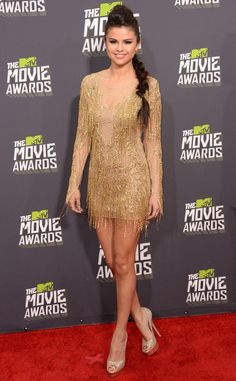 The 20-year-old starlet stole the spotlight in a beautiful beaded Julien Macdonald mini dress. Platform peep-toe heels and an edgy fishtail braid added sophistication to her glamorous look. at the MTV Movie Awards