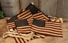 """Flags are about 7"""" apart on a 1/2"""" wide cloth garland ~ total length approx 9 feet. Have fun with this Patriotic Flag Garland. They are made of a semi sheer fabric and have been aged for a primitive look."""