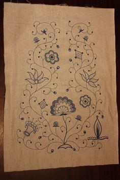 The design has been traced on the panel and has been embroidered.