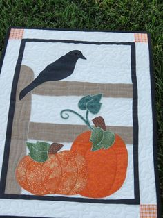 Pumpkin and Black Bird Autumn Quilted Wall Hanging with Applique Perfect for Fall. $48.00, via Etsy.