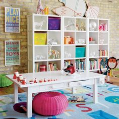 Kids playroom with ikea shelves - Like the configuration of 3 of the 8-cube cabinets.