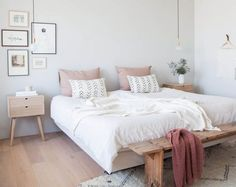 Another bedroom example with blush, blonde wood, and a minimal vibe