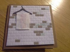 Tiled wall with birthday towel hanging. My unisex birthday card