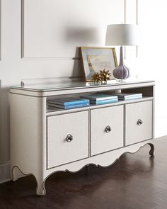 Console made of poplar wrapped in linen with nail head trim.
