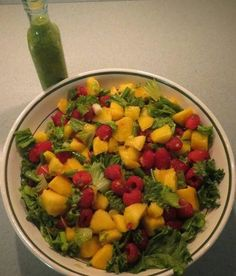 Fruit, kale, and mint come together gloriously in this minted mango raspberry salad from Dinner Is Served! Sweet and tart come together in this scrumptious salad to create a perfect marriage! Perfect for June, the season of weddings!
