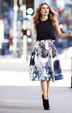 love this midi on midi look. black crop shirt & beautiful purple patterned midi skirt.: