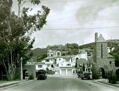 """The entrance to the Hollywoodland real estate development, which  opened in 1923, as it looked in 1927. The building at right-center with the """"Hollywoodland"""" sign on its roof just past the tower was and still is the real estate office."""