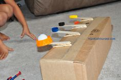 This looks like a great rainy day activity especially for boys! Homemade catapult....