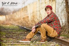 McKinney North High School senior, Ben sits on the train tracks.