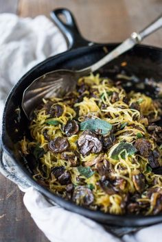 Roasted Spaghetti Squash with mushrooms, garlic and sage- a flavorful side dish ( or easy main) perfect for fall. Keep it vegan or add grated Romano cheese| www.feastingathome.com. Made Just Right. Plant Based. Earth Balance.