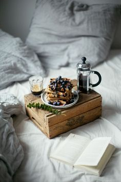 A dream caught in a picture: freshly brewed black coffee, waffles and a book.